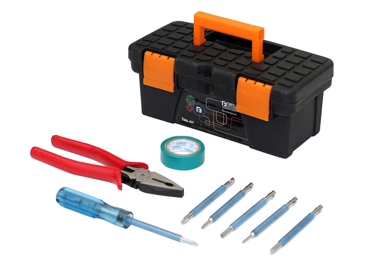 wire cutter and other tools beside a toolbox