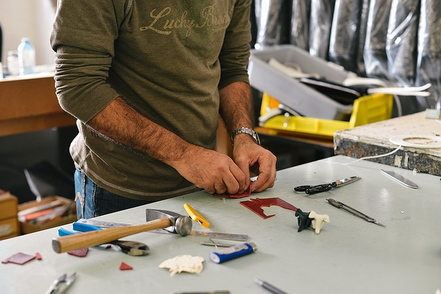 a man working on a work bench